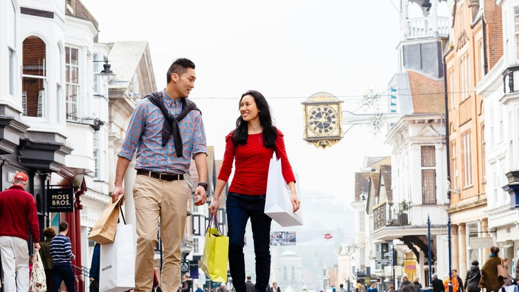 A Chinese couple shopping in Guidlford High Street