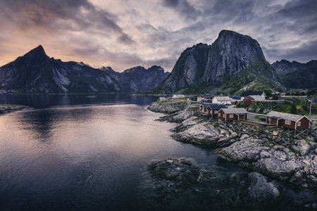 Image of a small Nordic village backed by a mountain range